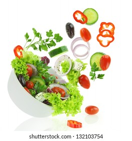 Diet vegetables salad. Fresh mixed falling into a bowl