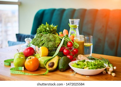 Diet weight loss breakfast concept with tape measure, organic fruits , vegetables, salad and fresh water. Healthy nutrition concept, Lifestyle and Eating