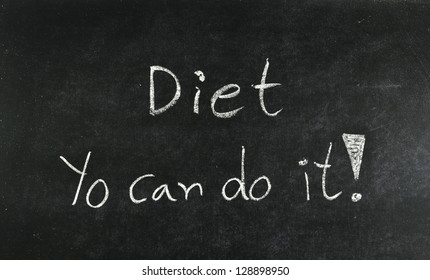 """""""Diet You can do it"""" word written on blackboard"""