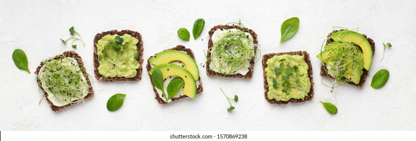 Dietary fitness toast with avocado, tofu cheese and microgreen, isolated on white, top view, panorama