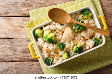 Dietary foods: rice baked with broccoli, chicken and cheese close-up in a baking dish. horizontal top view from above