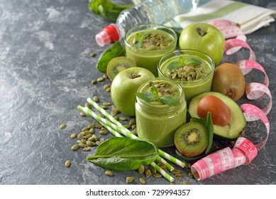 Dietary green smoothies on a gray background