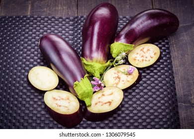 Dietary healthy food. Low-calorie product of healthy diet. Eggplant on the table. Still life of eggplants. Fresh sliced eggplant. Eggplant close up.