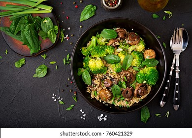 Dietary menu. Healthy vegan salad of vegetables - broccoli, mushrooms, spinach and quinoa in a bowl. Flat lay. Top view