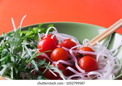Dietary menu. Vegan cuisine. Healthy salad with arugula, tomatoes and noodles