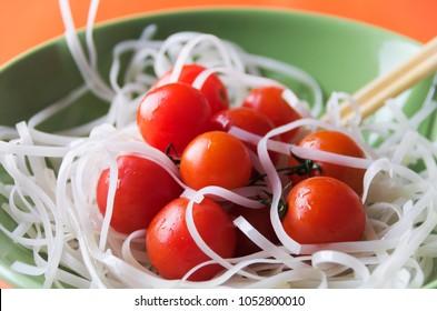 Dietary menu. Vegan cuisine. Tomatoes  and noodles