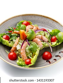 Dietary salad of avocado shrimp tomato and seasonings.