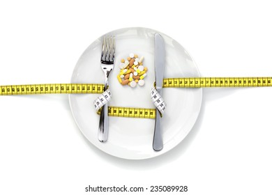 DIETARY SUPPLEMENT A dish with various drugs on it with a measure wrapped around fork and knife.
