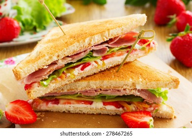 Dietary turkey sandwich and strawberry.