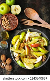 Dietary vegan apple salad with seeds and spices. Nutritious fitness salad with apples and spices.