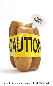 Dietary warning or gluten/wheat allergy warning (Fresh bread rolls wrapped in yellow caution tape, with Tasty Gluten tag - easy to remove text, on white background)