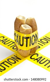 Dietary warning or gluten/wheat allergy warning (Slices of fresh French bread wrapped in yellow caution tape)