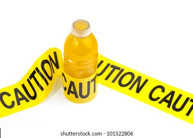 Dietary warning of high sugar drink (sugary sport drink bottle wrapped in yellow caution tape)