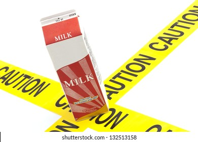 Dietary warning or lactose intolerance allergy warning (generic carton of milk on top of yellow caution tape)