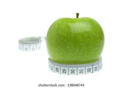 Dieting  concept - measurement and apple fruit