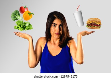 Dieting concept, young woman choosing between healthy food and junk food. Health vs unhealthy.