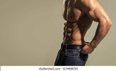 Dieting and fitness. Coach sportsman with bare chest. Athletic bodybuilder man on grey background. Sport and workout. Man with muscular body and torso, copy space