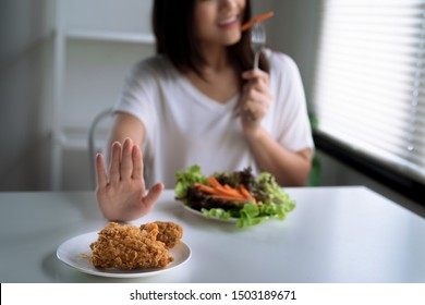 Dieting and good health concept, the young lady refused fried food and chose healthy food.