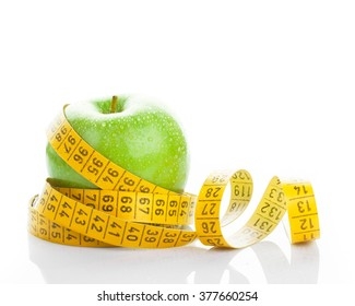 dieting, lose weight concept. apple with measuring tape