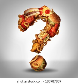 Dieting questions concept and diet worries with greasy fried fast food take out as burgers and hot dogs with fried chicken french fries and pizza shaped as a question mark for eating uncertainty.