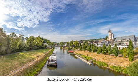 Diez, Germany - July 10, 2019: historic Diez castle at river Lahn , Rhineland-Palatinate, Germany. Fairytale view of castle from old town. Historic half-timbered houses in center of city .