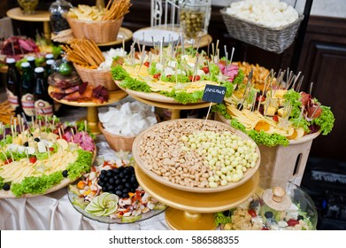 Diferrent peanuts, cheese, meat and salads on wedding reception.
