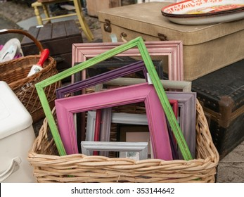 Differed coloured painted wood frames in a basket for sale at a vendor in Hay-on-Wye, Wales, United Kingdom, Europe.