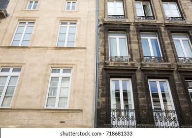 Difference between a wash cleaned house facade and a dirty one in a city center, before and after