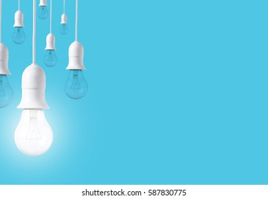 difference light bulb on blue background. concept of new ideas with innovation and creativity.