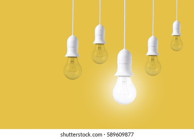 difference light bulb on yellow background. concept of new ideas with innovation and creativity.