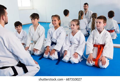 Different ages kids expressing interest in attending karate class