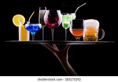 different alcohol drinks set on a tray  - beer, wine, cocktail,juice, champagne, scotch, soda