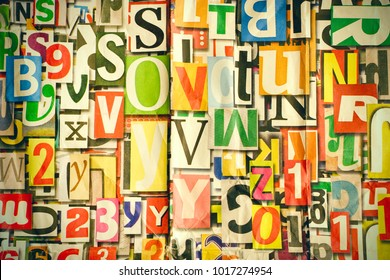 Different alphabet, letters and numbers as background on wall