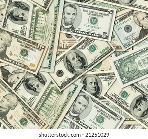 Different American Dollar bills banknotes piled together.