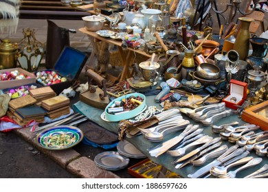 Different antiques on flea market or festival - vintage silver cultery - spoons, knifes, forks and other vintage things. Collectibles memorabilia and garage sale concept