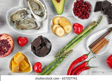 Different aphrodisiac food for increasing sexual desire on wooden table