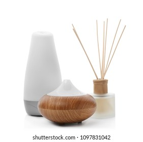 Different aroma oil diffusers on white background. Air freshening