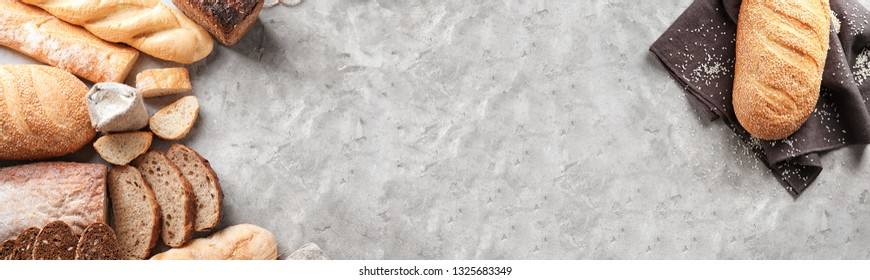 Different bakery products on grey background with space for text