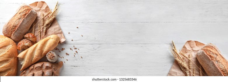 Different bakery products on wooden background with space for text