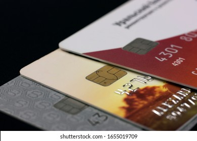 A lot of different bank credit cards with chips on a black background