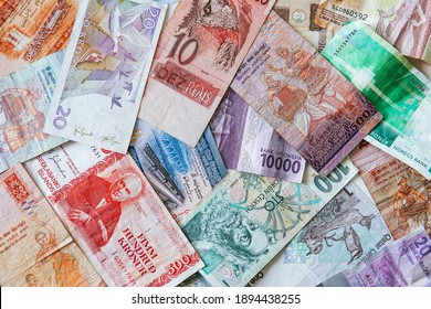 different banknotes from all over the world. all countries are suffering from the financial crisis. close up of cash from many different countries.