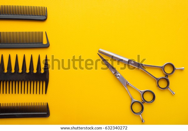 Different barber shop tools isolated on yellow background with copyspace