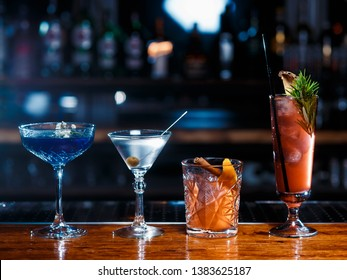 different beautiful cocktails on the wooden bar