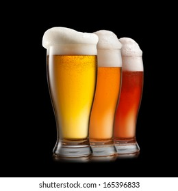 Different beer in glasses isolated on white background
