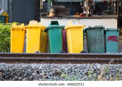 different bin type place beside a railway