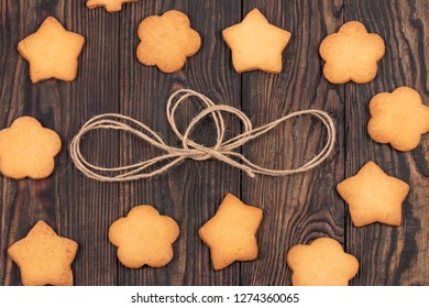 different biscuits on a wooden table around a whip stitch