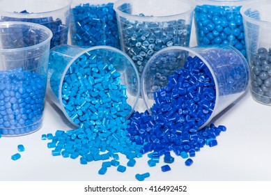 different blue dyed polymer granulates on white