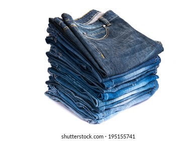 Lot of different blue jeans isolated on white background
