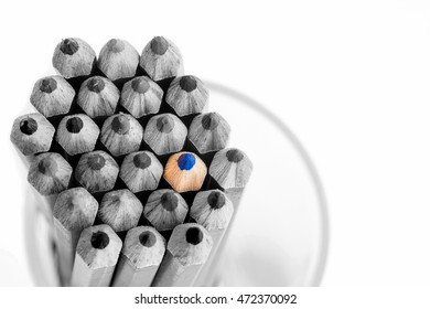 Different blue pencil in a glass on white background