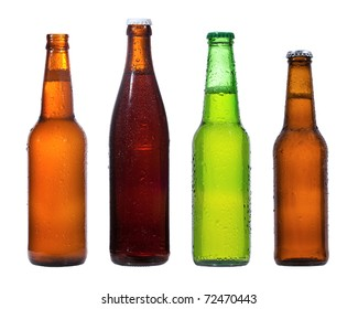 Different bottles of beer with water drops on white background